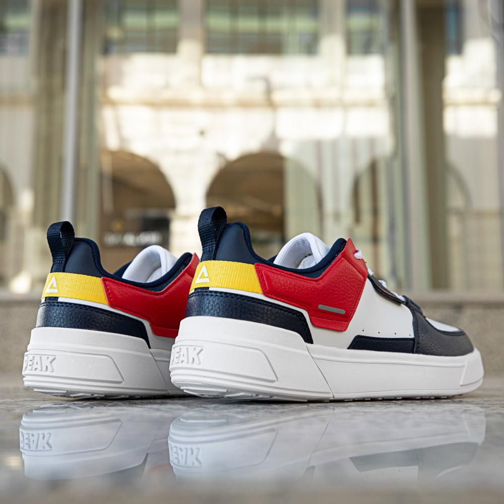 Chaussure multi couleurs blanc noir jaune rouge