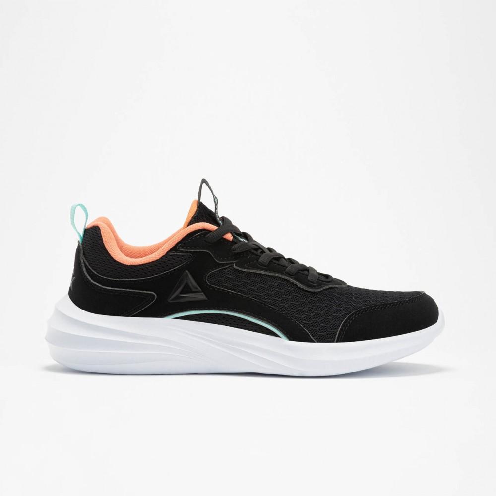 détail de chaussure femme noir blanc orange de running
